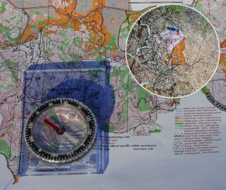 [Orienteering map, compass, and a control bag.]